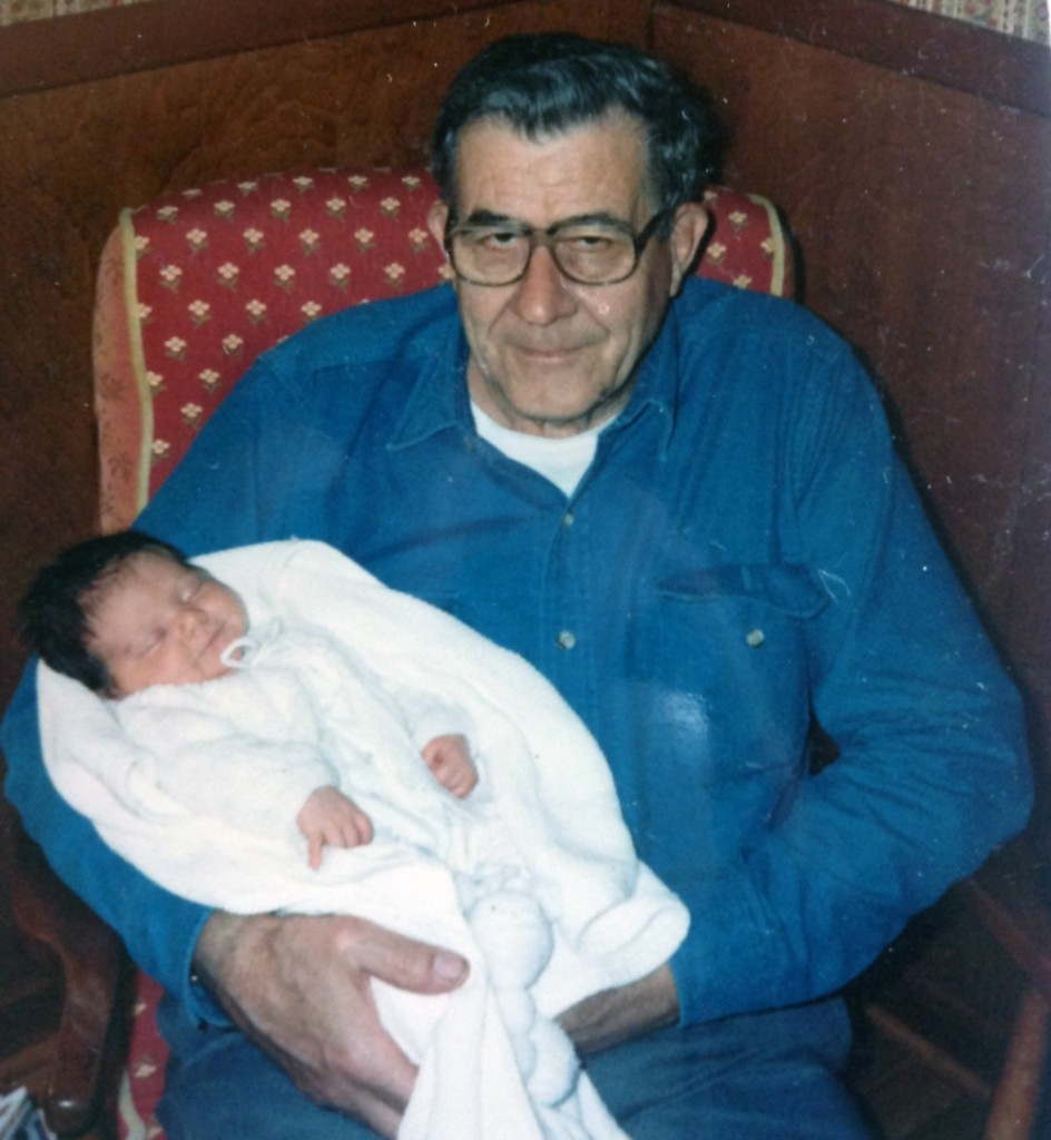 Grandpa holding Ellynne, my daughter, about 21 years ago